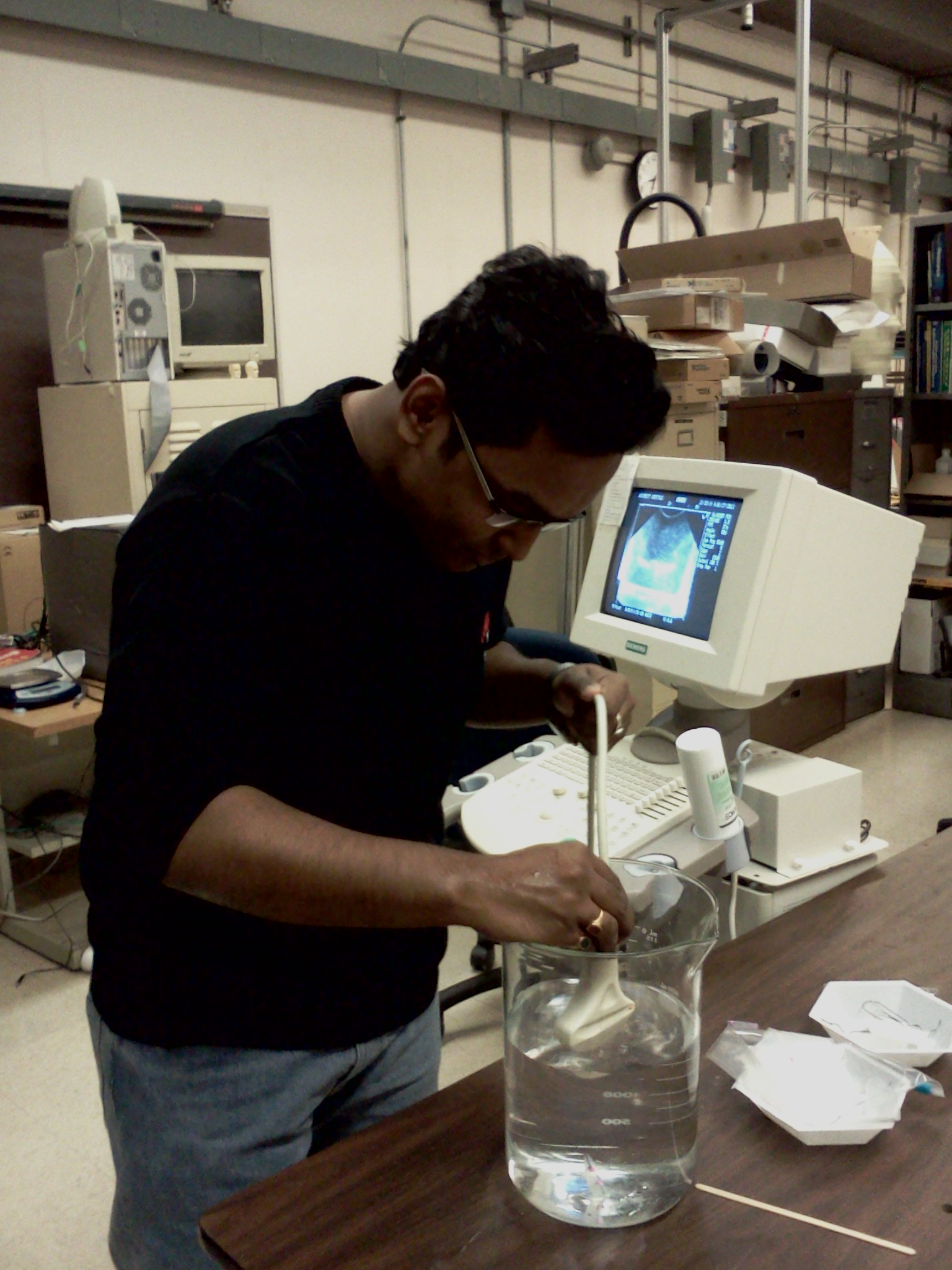 Abhishek Basak in the lab experimenting with Ultrasound machine
