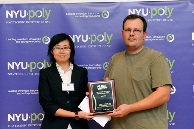 Xinmu Wang accepts the 3rd prize in CSAW 2010 competition
