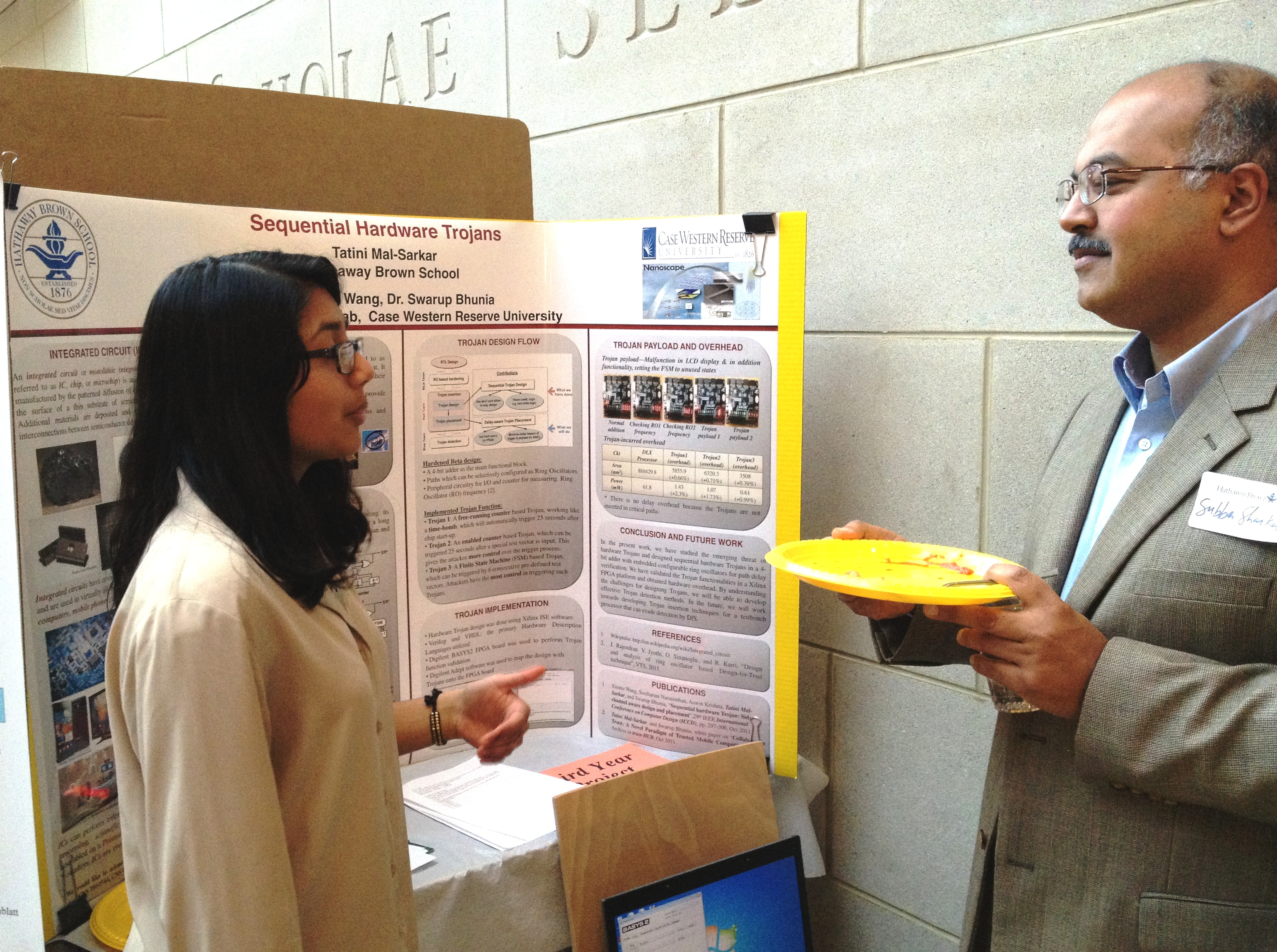 High school student Tatini Mal-Sarkar presenting her award-winning poster in a poster session at Hathaway Brown high school